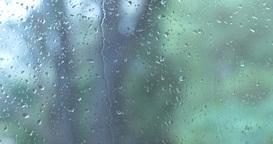 Rain drops on window glass wet weather Footage