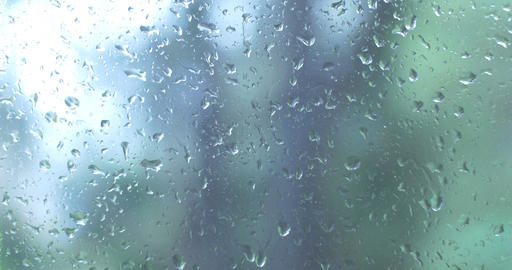 Water Rain drops on window glass wet weather Footage