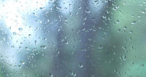 Water Rain drops on window glass wet weather Footage