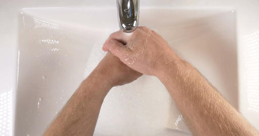 Washing hands in sink with soap to clean skin for good hygiene Footage