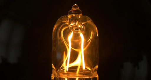 filament in light bulb isolated glow slow flashing Footage