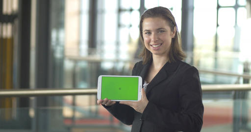 Holding greensreen tablet ipad business person smiling in office Footage