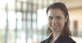 Beautiful smiling confident business woman looking at camera isolated office Footage