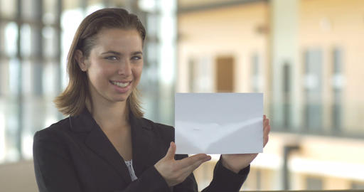 Logo sales promotion woman in suit holding blank white card Footage