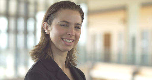 Young Casual Business Woman Smiling Portrait Close Up Office Backround stock footage