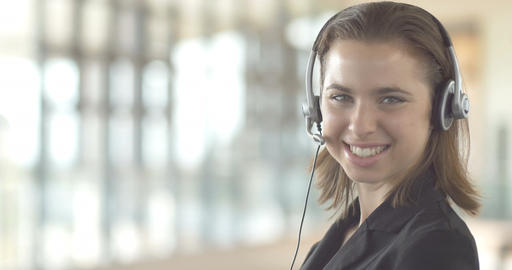 Close-up of smiling woman promo in a call center customer service Footage