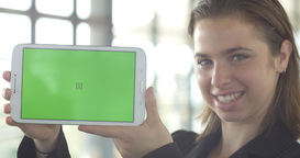 Business woman holding greenscreen tablet ipad portrait smiling Footage