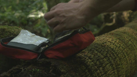 Survival first aid kit with bandage in forest outdoors Footage
