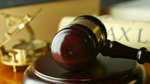 Tax Law justice litigation concept with gavel and hammer Live Action