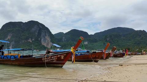Longboats on Phi Phi Island Thailand - Holiday Travel Destination Footage
