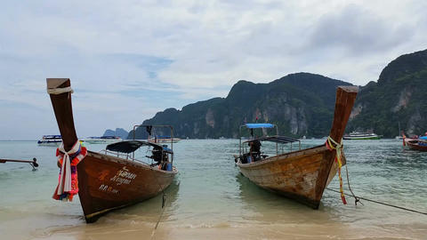 Longboats on Phi Phi Island Thailand - Holiday Travel Destination Footage