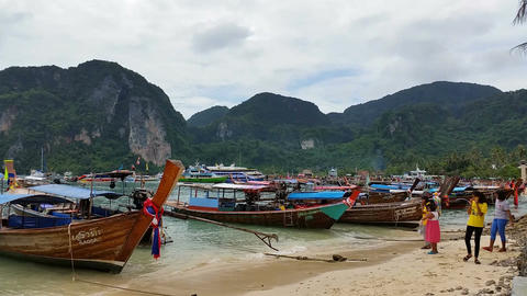 Longboats on Phi Phi Island Thailand - Holiday Travel Destination Live Action