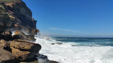 Waves on rocks along Coastal Sandstone cliffs Footage
