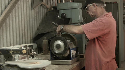 Lifestyle 50s-60s Man working indoors in hobby shed or workshop with carpentry p Live Action