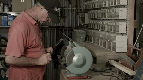 Man working indoors in hobby shed or workshop with carpentry power tools Footage