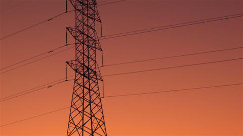 Energy Transmission Power Line Tower Pylon Structures at Sunset Footage