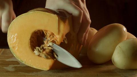 healthy fresh food prep cutting up of vegetable pumpkin potato in kitchen Footage