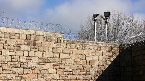 Prison Jail Gaol razor wire and security, Australia Footage