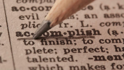 Accomplish - Fake dictionary definition of the word with pencil underline Live Action