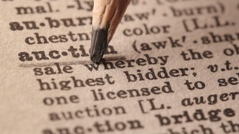 Auction - Fake dictionary definition of the word with pencil underline Live Action