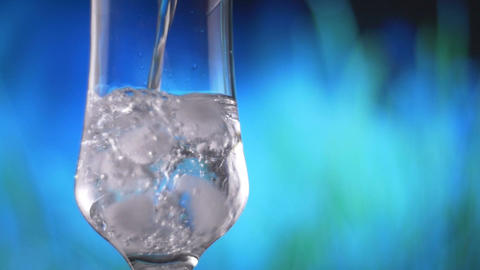 Ice Cube Water pouring into glass slow motion fresh natural cool with bubbles Footage