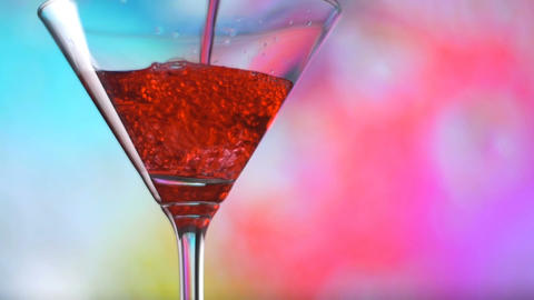 Cocktail Soft drink soda pour into glass slowmotion on colorful background 影片素材