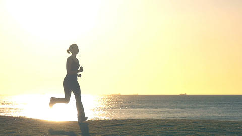 woman jogging isolated in park by beach early morning exercise slowmo Footage
