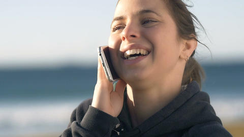 Female Girl talking on phone smiling looking happy outdoors Footage