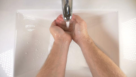 Washing hands in sink with soap to clean for good hygiene Footage
