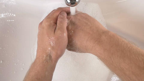 Hands in sink washing with soap to clean for good hygiene Footage