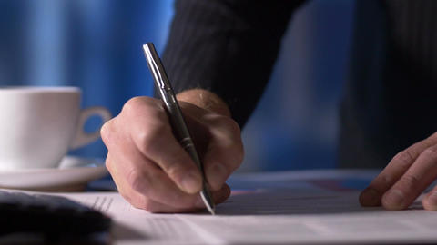 Businessman Looking At Documents Signing Paperwork In Office At Desk stock footage