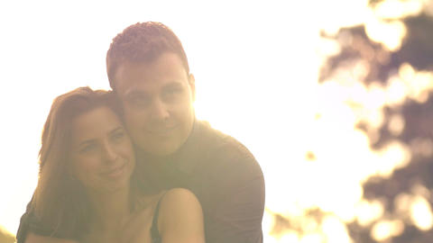 Young couple in loving relationship hugging outdoors lifestyle Footage