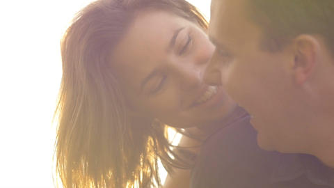 Portrait of young couple in love laughing being happy outdoors sunset lifestyle Footage