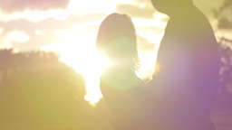 Sunset dreamy romance of a young couple in love park sunset slow motion Footage
