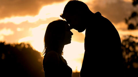 silhouette of romantic young couple in love park sunset slow motion lifestyle Footage