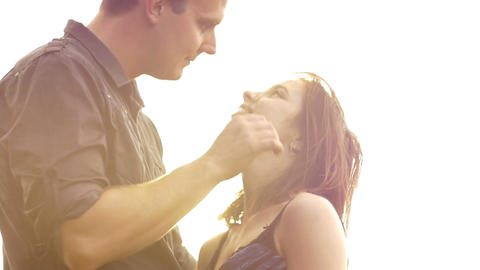 Kissing romance of a young couple in love park sunset slow motion lifestyle Footage