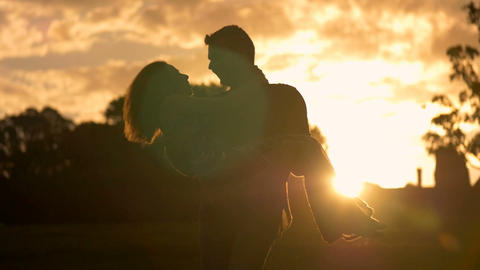 Romance of a young couple in love park sunset slow motion Footage