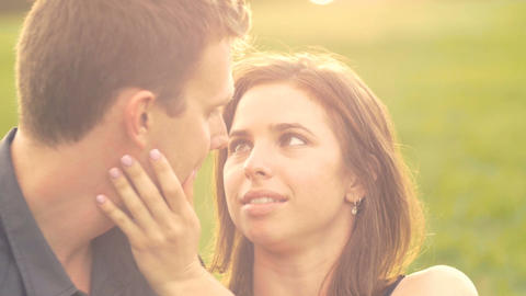 Heterosexual Young couple in love park sunset slow motion lifestyle Footage