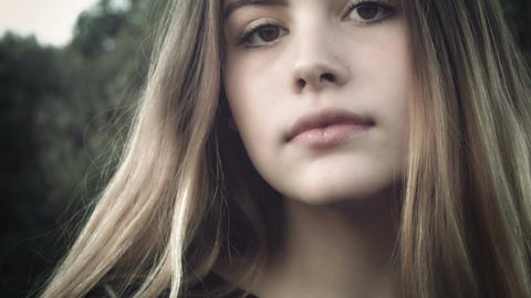 close up eyes and face beautiful young girl model looking at camera Footage