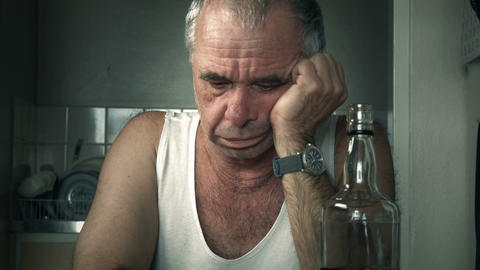 Depressed adult male person crying suffering Alcoholism and Loneliness Footage