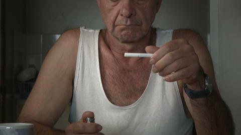 lighting and smoking a cigarette adult male with drug…, Live Action