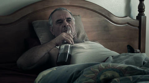 Alcoholic Adult in Bed Drunk Suffering Drug Effects of Alcoholism Live Action