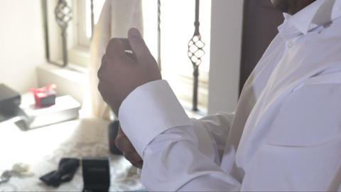 man buttons up white wedding shirt cuffs with cufflinks Footage