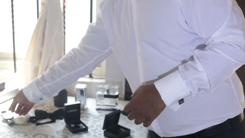 man in white wedding shirt clasps watches on hand Footage
