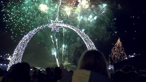 People staring at fireworks with christmas lights in foreground Footage