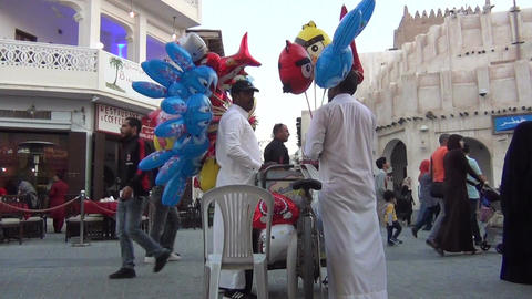 Men selling balloons at souq Waqif Live Action