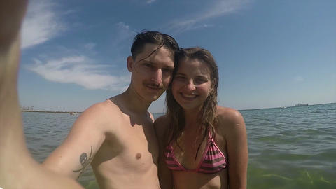man and a girl made of selfie in the sea Footage