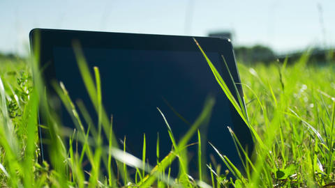 Tablet PC On The Grass stock footage